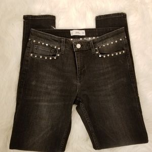 MNG black jeans with round studs.